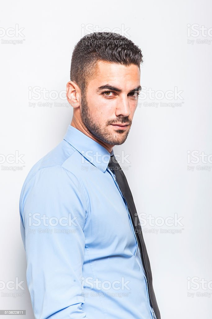 Single Elegant Man In Blue Shirt With Black Tie Stock Photo