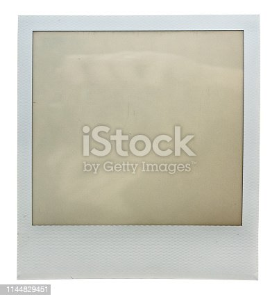 1183352589 istock photo single empty or blank instant film frame or photo placeholder on real background 1144829451