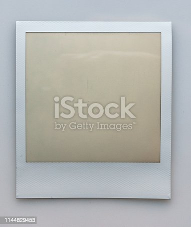 1183352589 istock photo single empty or blank instant film frame or photo placeholder on real background 1144829453