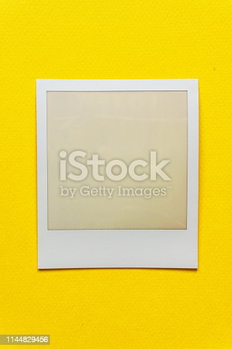 1183352589 istock photo single empty or blank instant film frame or photo placeholder on real background 1144829456