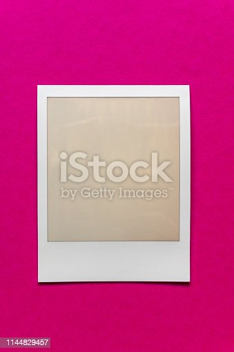 1183352589 istock photo single empty or blank instant film frame or photo placeholder on real background 1144829457