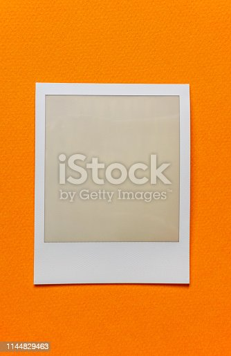 1183352589 istock photo single empty or blank instant film frame or photo placeholder on real background 1144829463