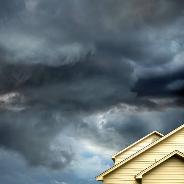 single family house over tropical storm stock photo