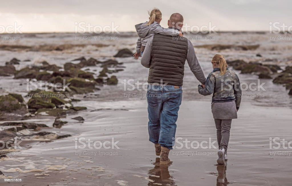 Handsome redhead single father and his blonde daughters playing...