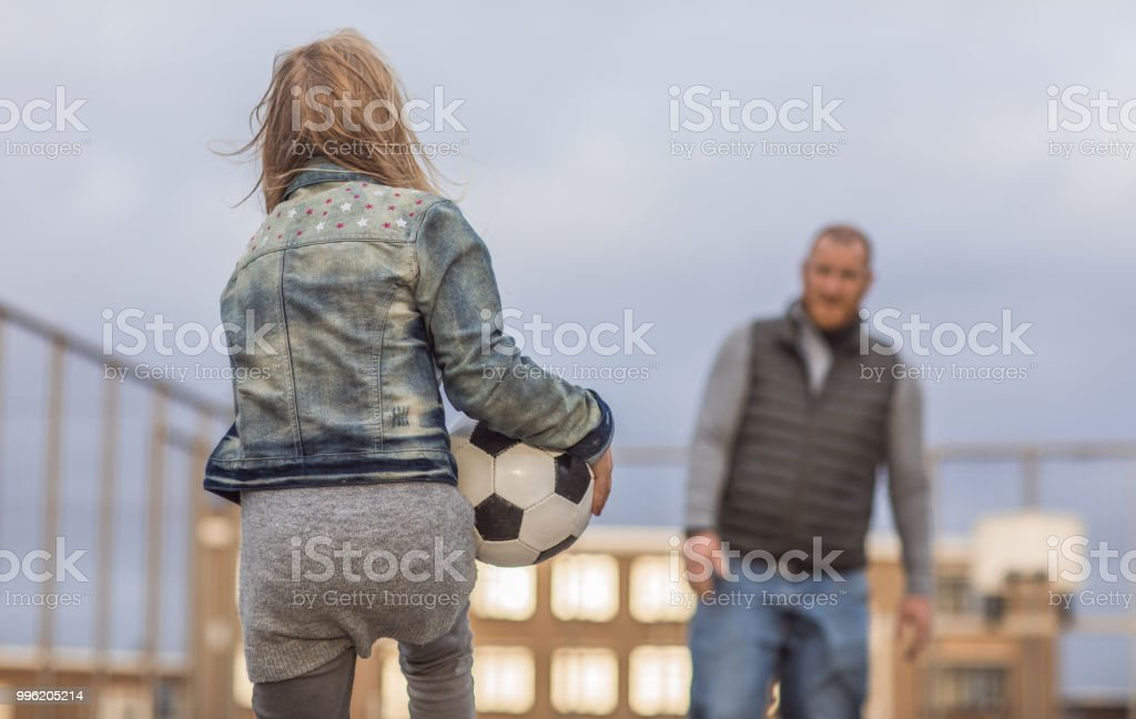 Single handsome redhead father and his blonde daughters playing...