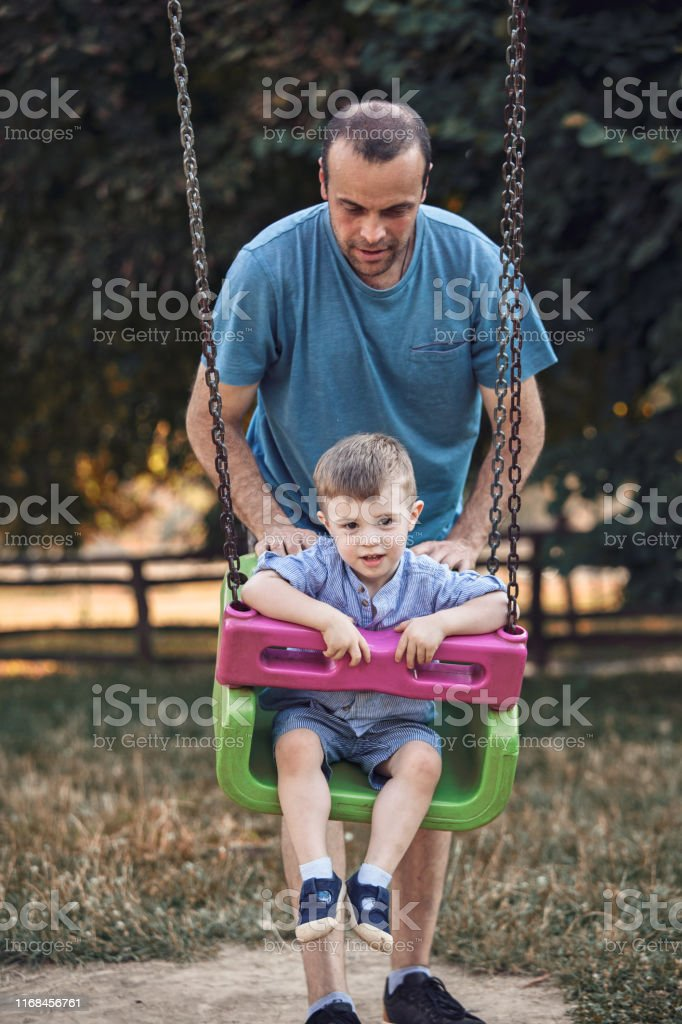 Single parent spending quality time with his son in nature. Models on...