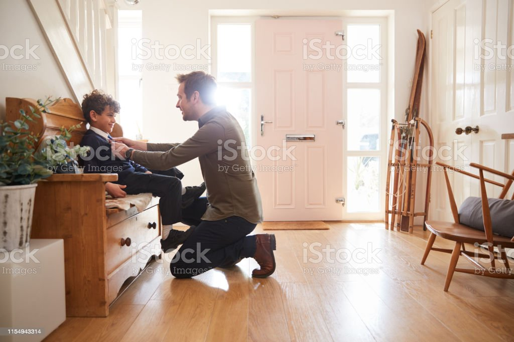 Single Father At Home Getting Son Wearing Uniform Ready For First Day...