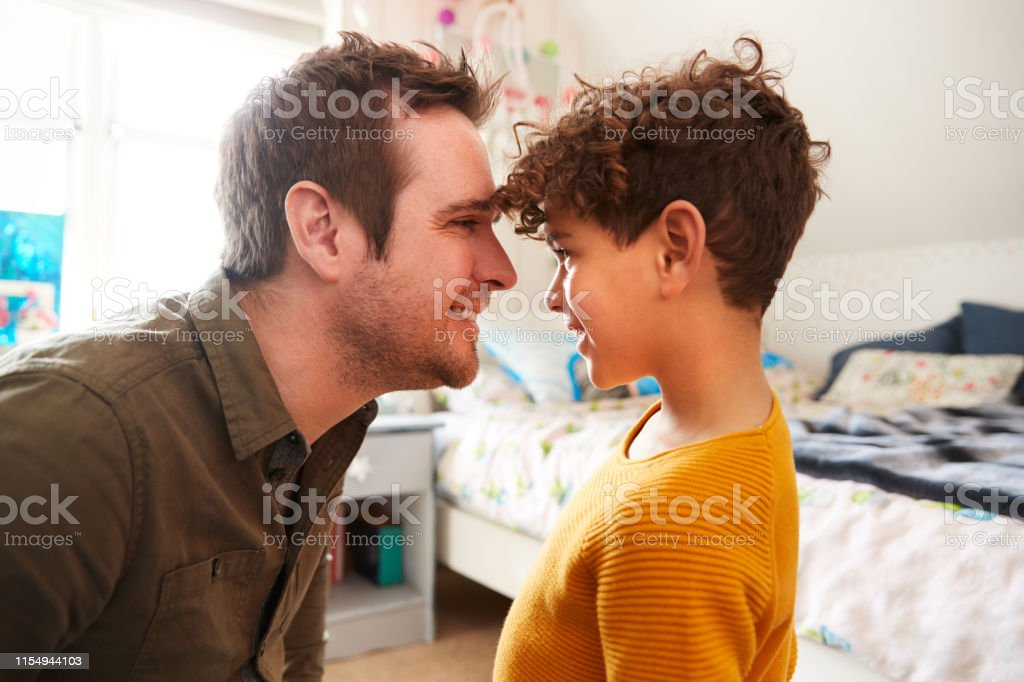 Single Father Head To Head At Home With Son In Bedroom At Home