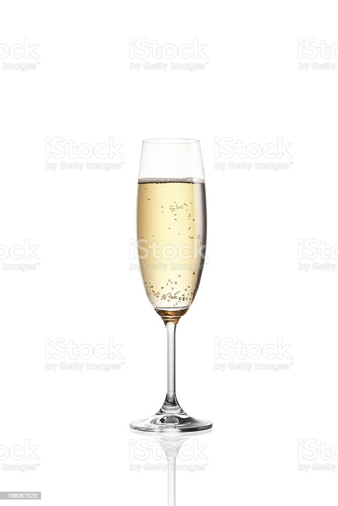 A single filled glass of bubbly champagne stock photo