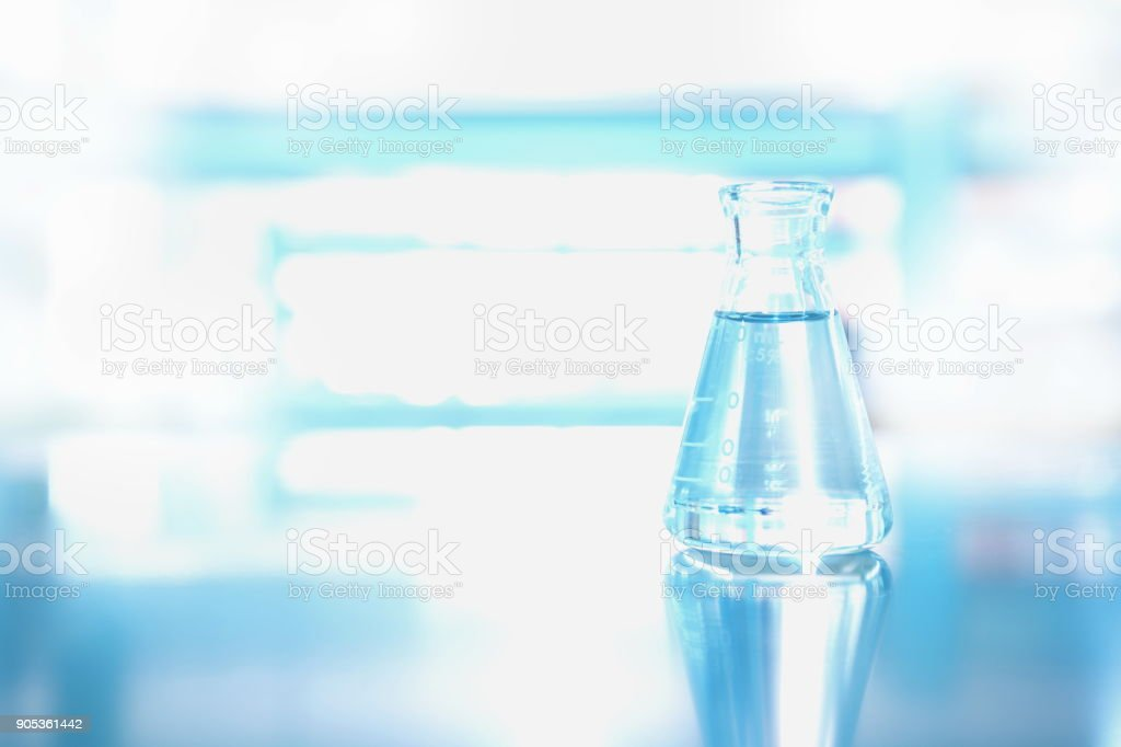 single flask with water in science chemical environment laboratory stock photo
