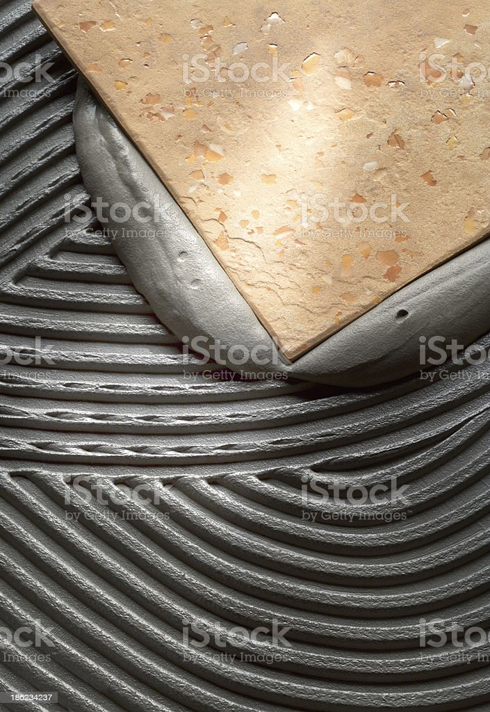 Single floor tile being installed stock photo