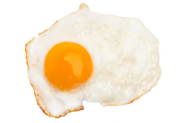 single fried egg isolated on white background - fried egg stock photos and pictures