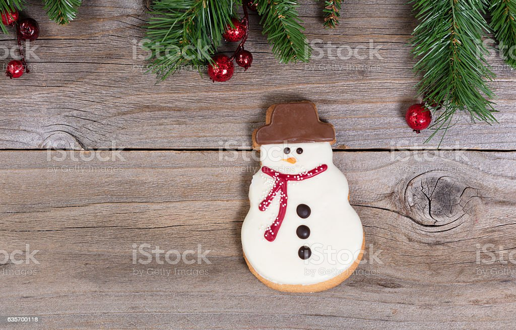 Single frosted snowman cookie for the holiday season royalty-free stock photo