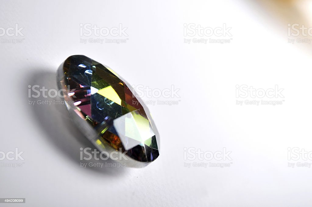 Single gem reflecting light and colour stock photo