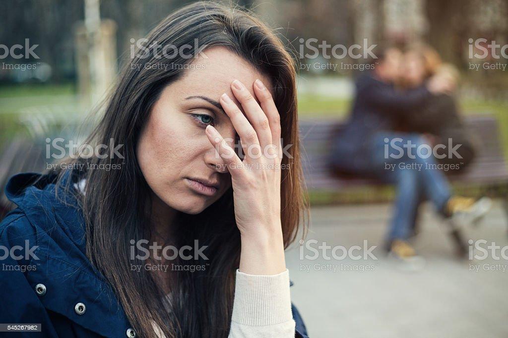 Single girl feeling lonely stock photo