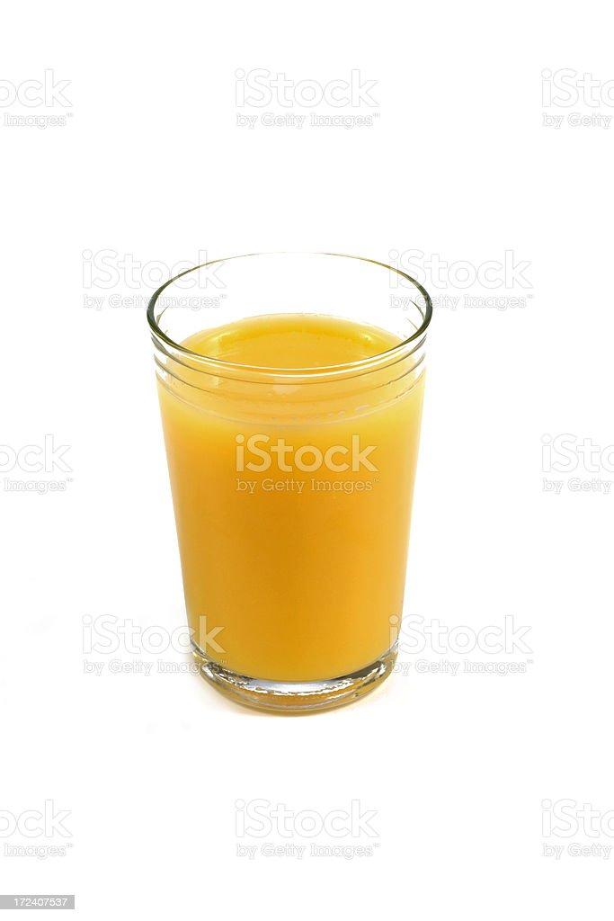 Single glass full of orange juice against white background. stock photo