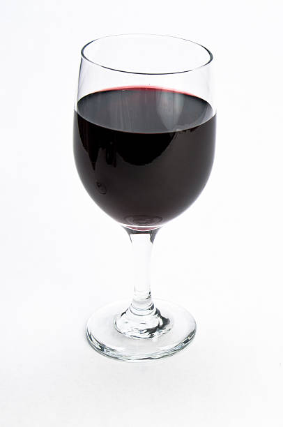 Single glass of red wine on isolating background stock photo