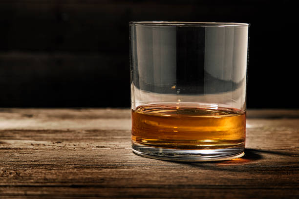 single glass of straight bourbon - whiskey stock photos and pictures