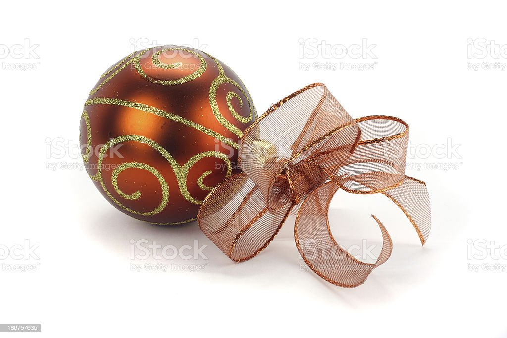 Single gold bauble and brown glittery ribbon isolated on white royalty-free stock photo