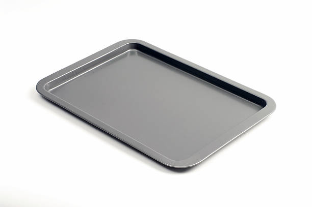 single gray baking tray isolated on white - bakplåt bildbanksfoton och bilder
