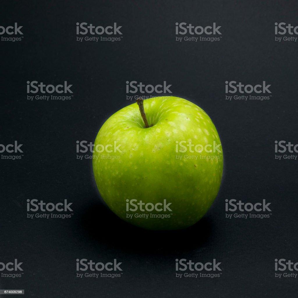 Single green apple on black background. royalty-free stock photo