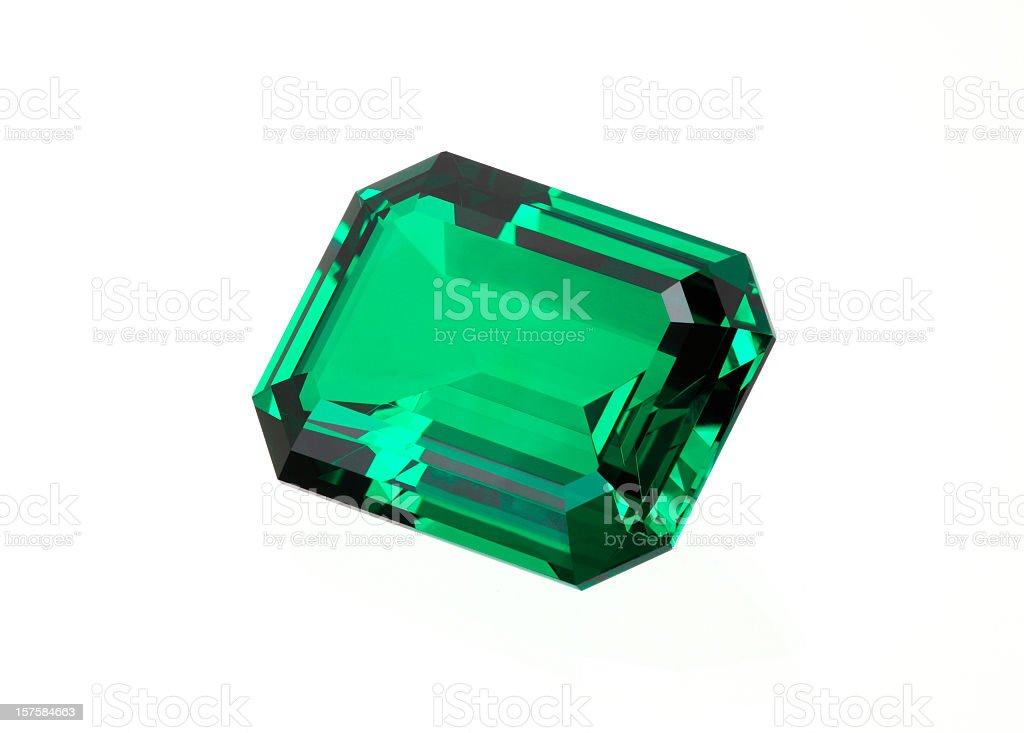 Single green emerald stone on a white background stock photo