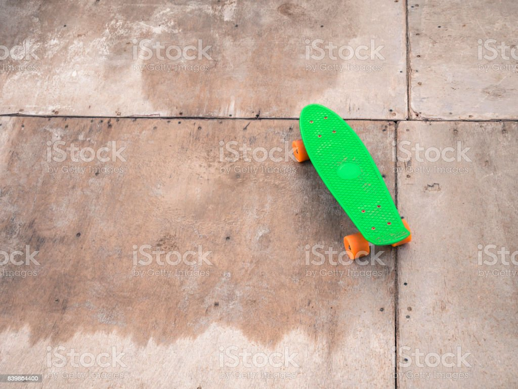 Single Green Penny Board On A Wooden Halfpipe Stock Photo More Pictures Of Alternative Lifestyle