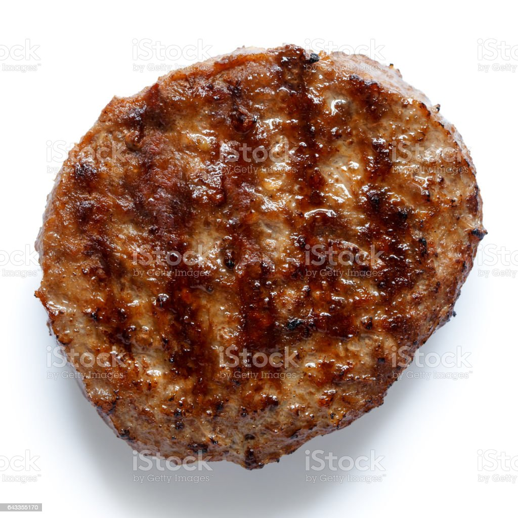 Single grilled hamburger patty isolated on white from above. stock photo