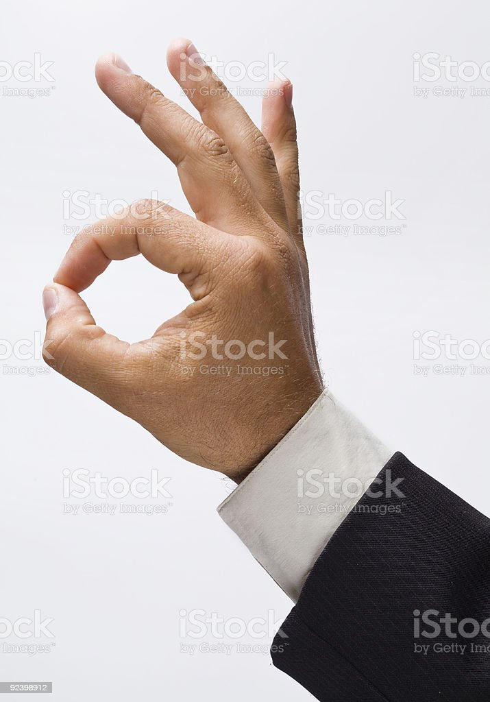 A single hand giving an okay sign royalty-free stock photo