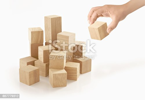 657779378 istock photo Single hand playing wooden box on isolated background. 657779312