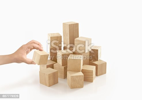 657779378 istock photo Single hand playing wooden box on isolated background. 657779326