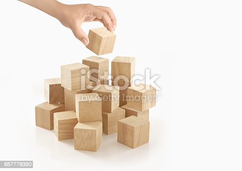 657779378 istock photo Single hand playing wooden box on isolated background. 657779350