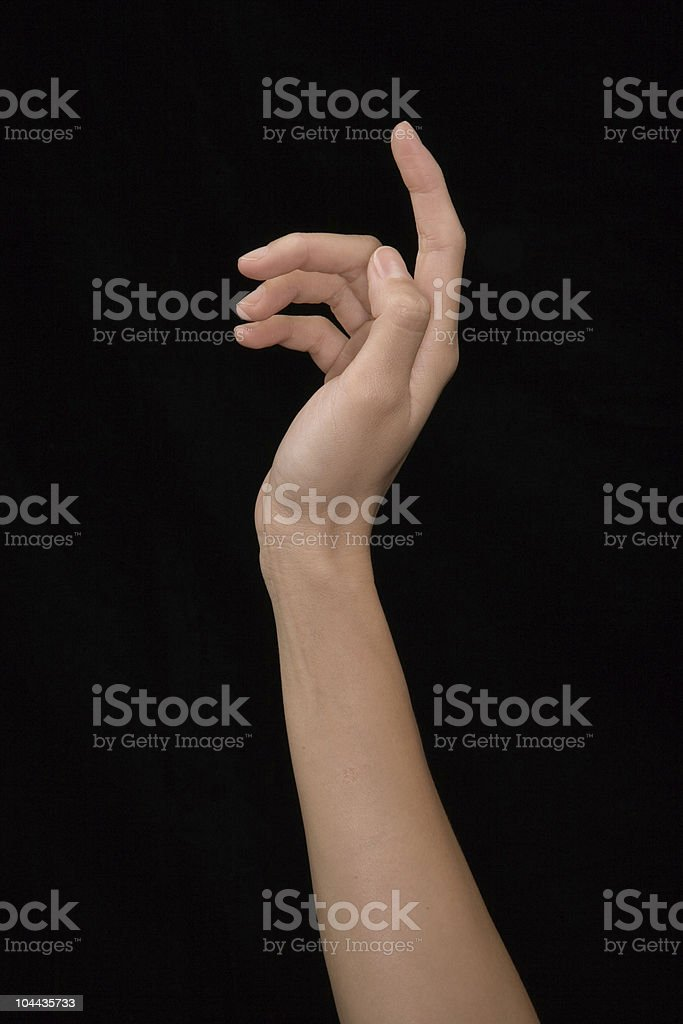 Single hand raised in the air over a black background stock photo
