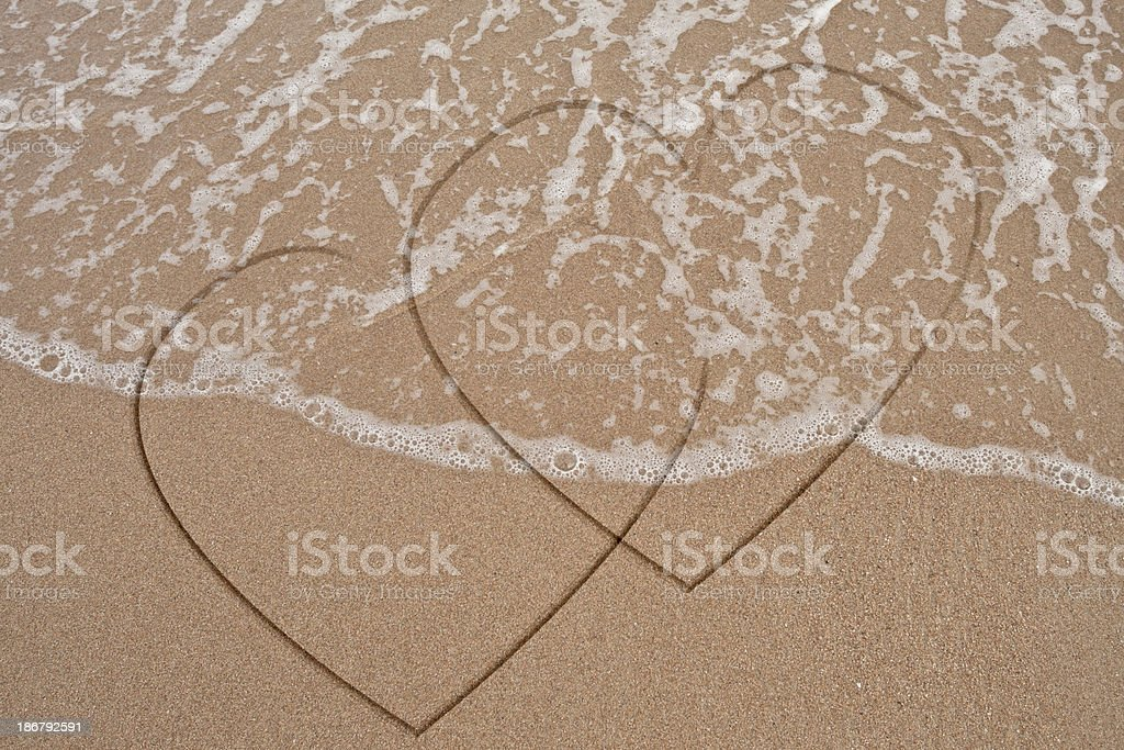 Single heart hand draw on sand royalty-free stock photo
