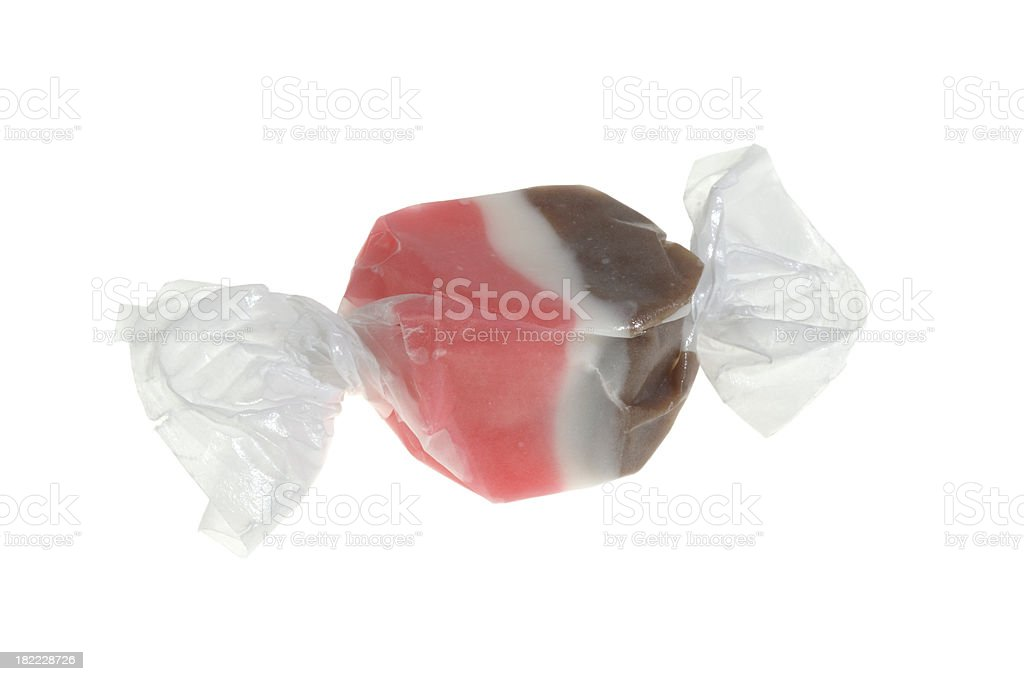 Single isolated piece of salt water taffy on white background stock photo