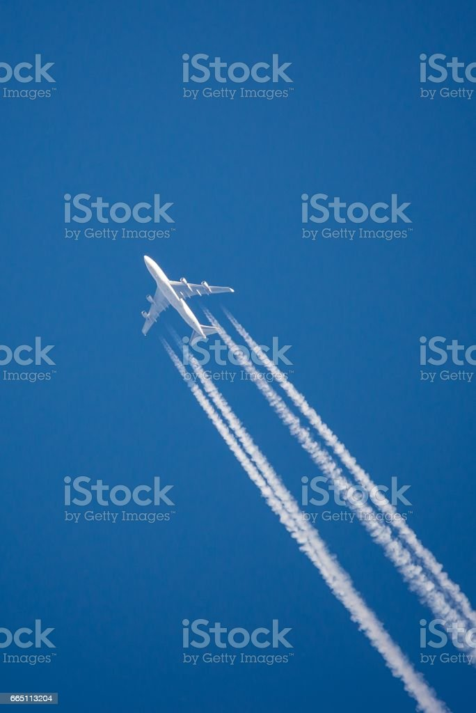 Single jet with visible smoke lines stock photo