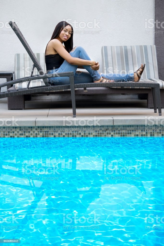 Single Lady On A Solo Vacation By A Hotel Pool Stock Photo