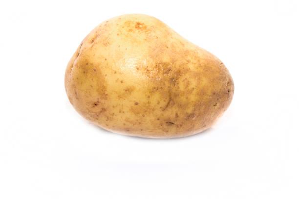 Single large yellow potatoe on a white background stock photo