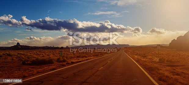 istock Single line road country side Arizona USA 1286415694