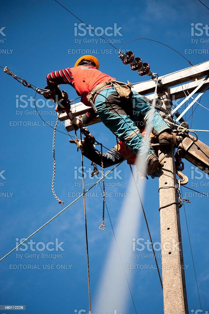 Single Linemen Working stock photo