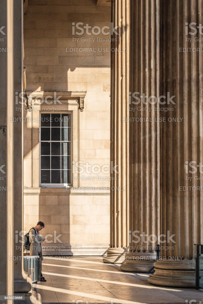 Single male standing outside the British museum stock photo