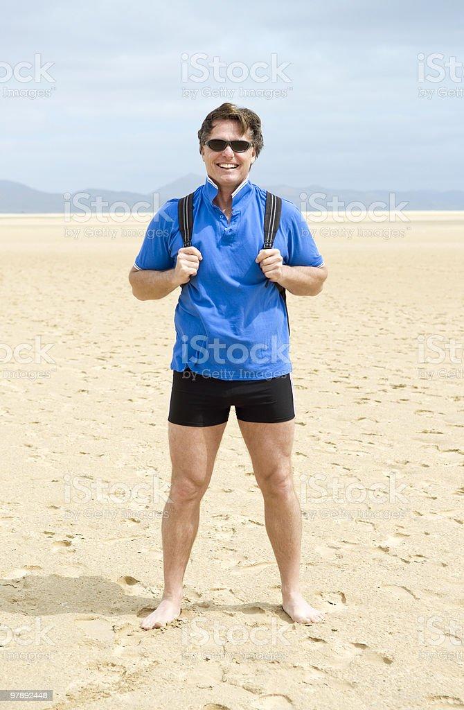 Single male traveller on beach. royalty-free stock photo