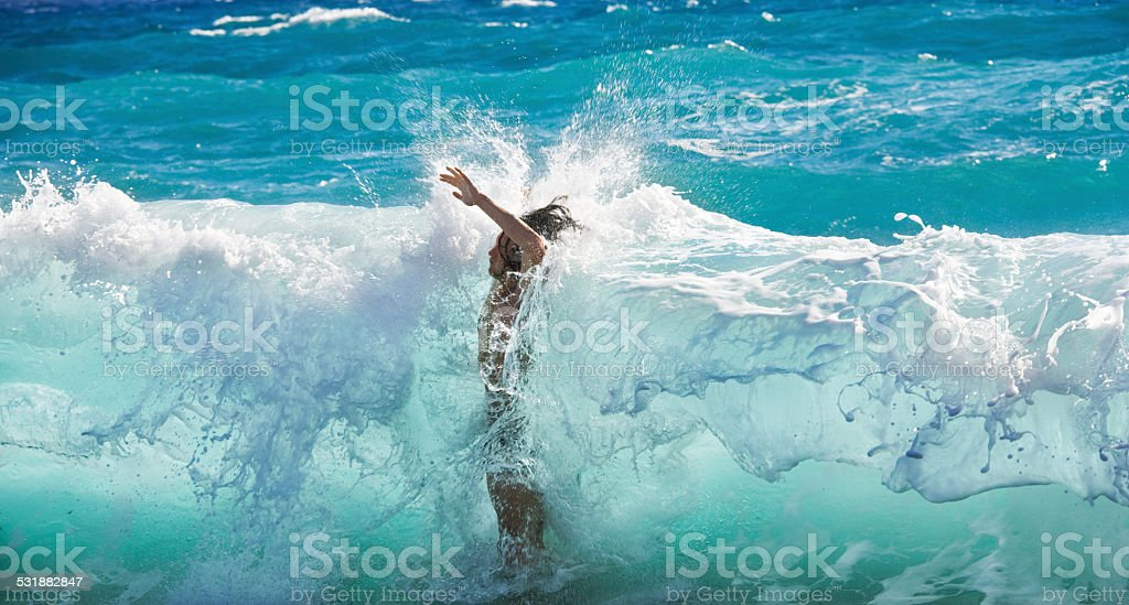 single man hit by huge wave stock photo