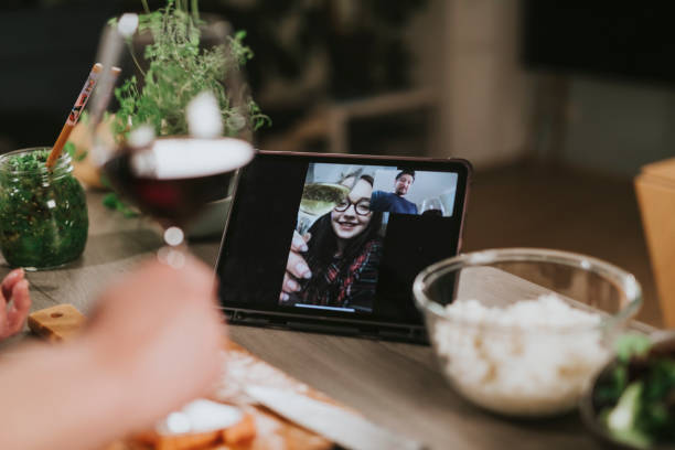Single man is having a romantic dinner with video call during lockdown stock photo