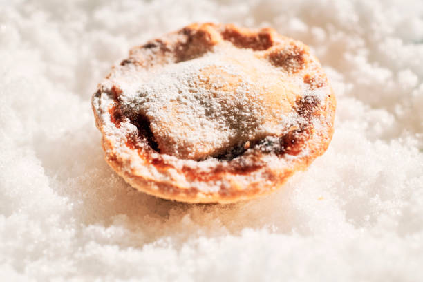 Single Mince Pie on a snow background. stock photo
