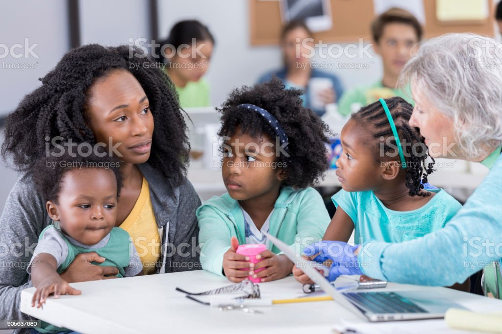 Single mom visits free clinic with her children stock photo
