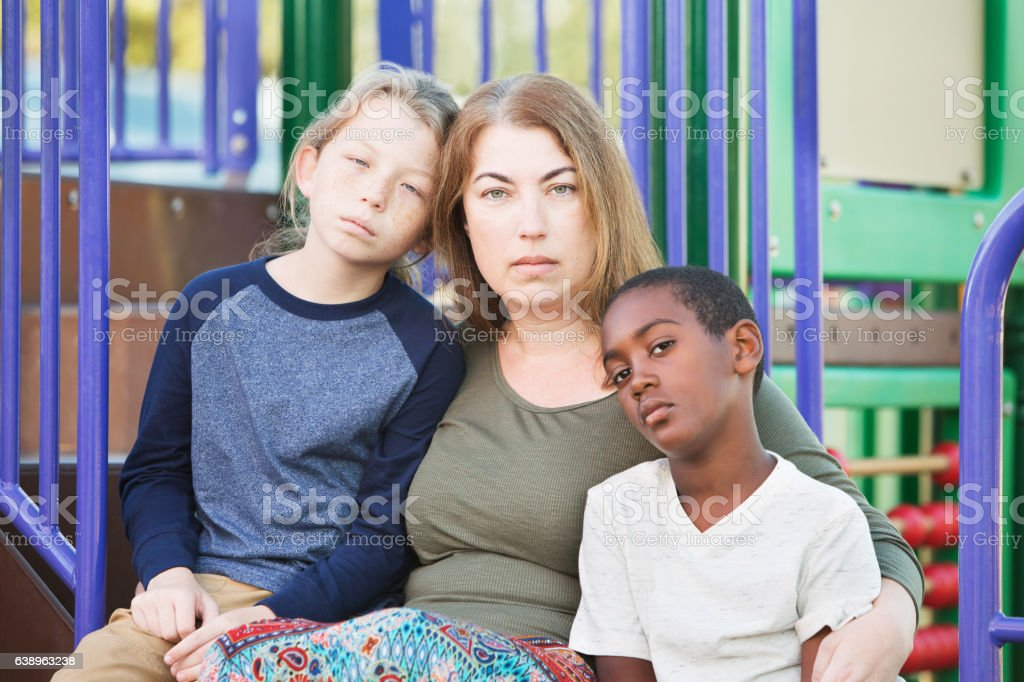 Single mom with sons outside stock photo