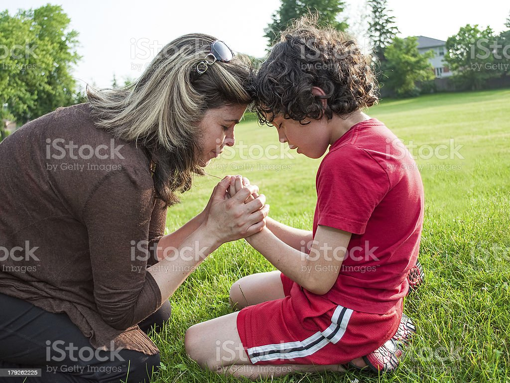 Single Mother and Son Praying stock photo