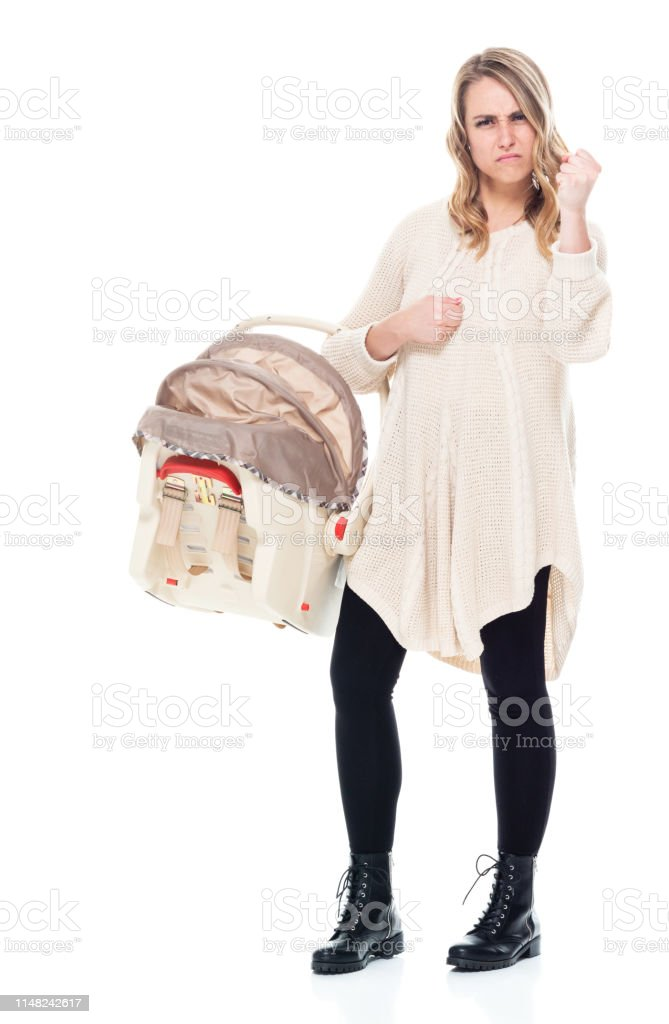 Single mother wearing a sweater with baby car seat - fighting stance