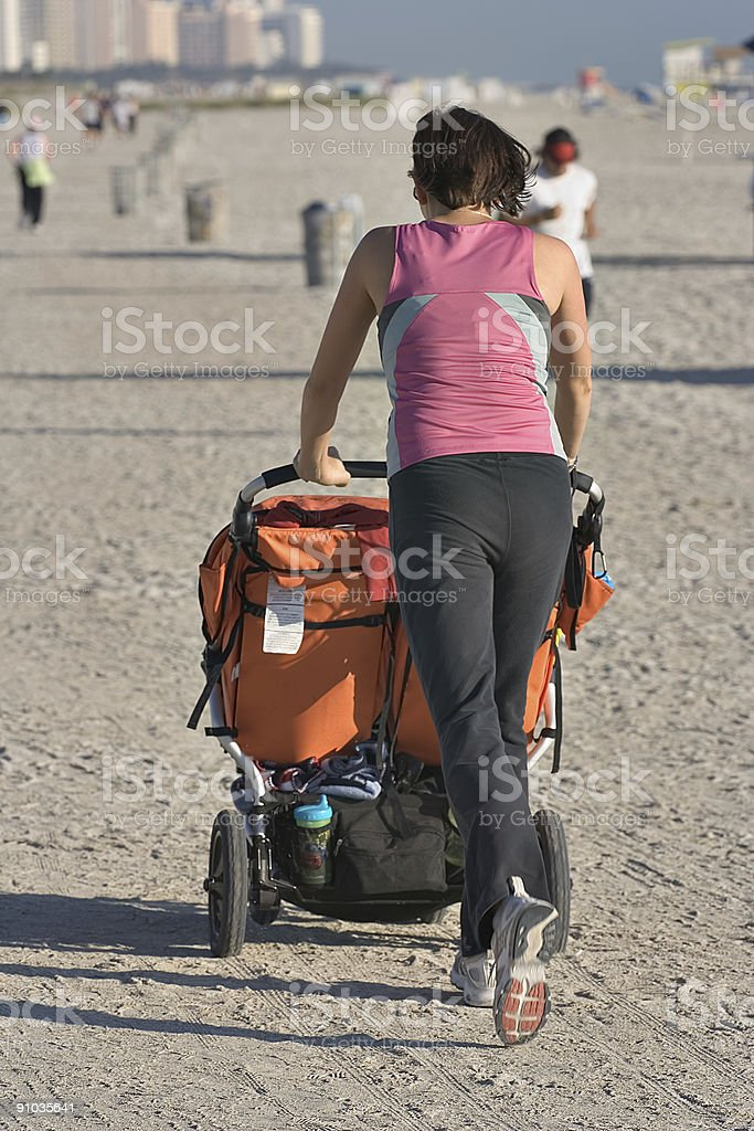 Single mother with twins jogging on Miami Beach royalty-free stock photo